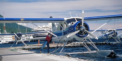 people getting on a floatplane