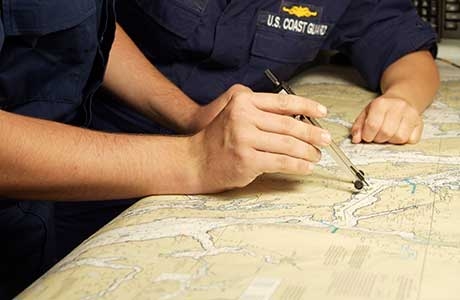 coast guard working a map